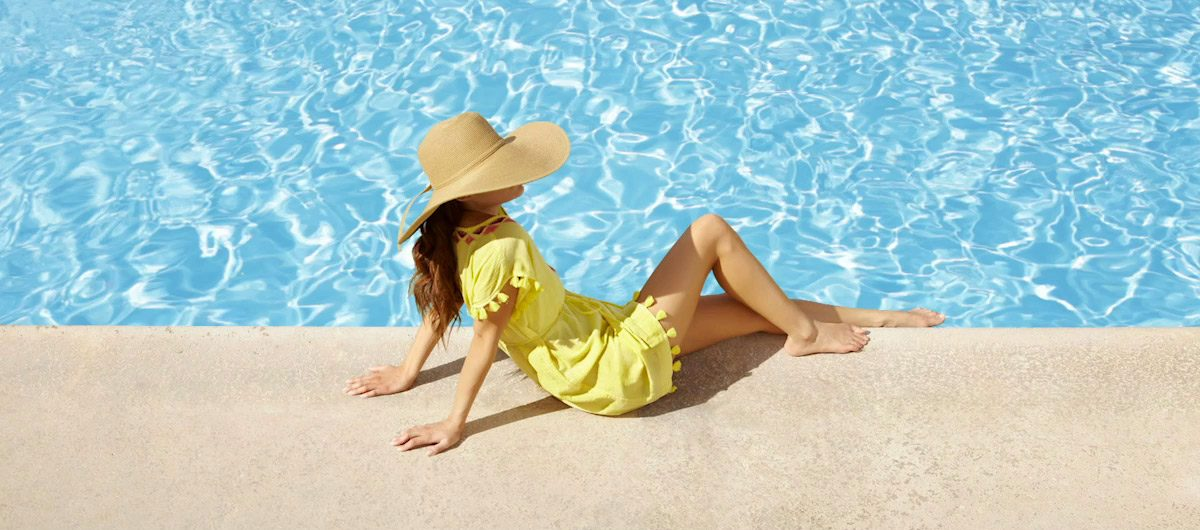 Woman sitting by pool